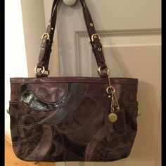 Lovely Brown Coach Purse Lovely Brown Coach purse - normal wear has slight discoloring on the sides near the top of the side pocket - but you can't really tell - great purse and has lots more wear to go! Coach Bags Shoulder Bags