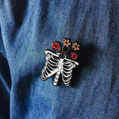 Ribs with Flowers Enamel Pin ( Skeleton enamel pin, flowers enamel pin, skeleton with flowers, ribs with flowers, halloween pin) Jacket Pins, Shirt Pins, Stuff And Thangs, Cool Pins, Pin And Patches, Pin Badges, Cute Jewelry, Lapel Pins, Little Things