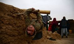 <strong>Mazar-i-sharif, Afghanistan</strong> A child plays at a camp for the internally displaced. As winter sets in across Central Asia, many Afghans struggle to provide adequate food and shelter for their families