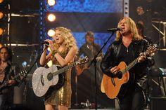 Taylor Swift and Def Leppard's Joe Elliott entertain the audience.