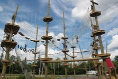 Visitors to the Wild Acadia Fun Park in Trenton climb through the ropes course, the Aerial Adventure, on July 6, 2012. The ropes course and ...