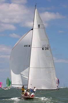 The  8 metre class yacht 'Athena' racing during Cowes Week.