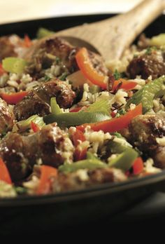 This one-skillet dinner features the mouthwatering flavors of sausage and peppers, all served on a zesty bed of brown and wild rice. Try this quick Savory Sausage & Rice Skillet tonight. Sausage Rice, Sausage And Peppers, Stuffed Peppers, Entree Recipes, Yummy Recipes, Dinner Recipes, Yummy Food, Skillet Dinners, Skillet Recipes