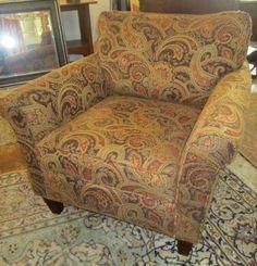 simular to my paisley chair that has tan, dark brown, burgandy and green tones