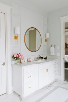 Marble bathroom vanity with gold mirror