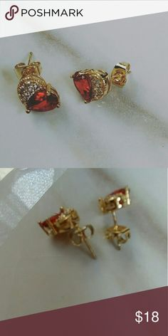 Dainty jewelry stud earrings The perfect mother's day present 18k gold plated, half of the heart is a red cubic zirconia grade A,  other half is CZ paved in clear color. Made in USA About 5 mm. Alquimia Jewelry Earrings