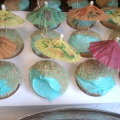 Beach theme cupcakes using blue food coloring and crushed up Graham crackers for sand.