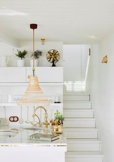 A summer house on the Italian coast. All white kitchen.