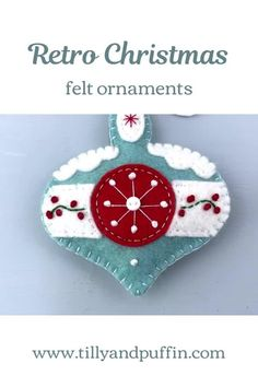 A retro style felt Christmas ornament. The appliqued and embroidered design is inspired by mid century glass ornaments.The bauble measures 4 inches/10cm high and has a loop for hanging. The front is decorated and the reverse is plain felt.The price included worldwide shipping.