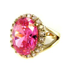 Jacqueline Kennedy's Pink Kunzite Ring - President John F. Kennedy purchased an 18 karat gold ring set w/ a pale pink Kunzite stone encircled by diamonds in the fall of 1963, intending it to be a Christmas gift for Jackie. Tragically, he was assassinated before he was able to give it to her, but she understandably treasured this last gift from her late husband & wore it throughout the rest of her life - repro at John F. Kennedy Presidential Library & Museum's Online Store.