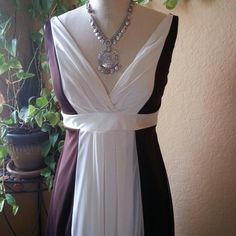Alyn Paige dress Look sizzling this summer in this Alan Paige dress. It has an empire waist, deep neckline to highlight that summer color and an adorable tie-back. Accented in rich brown and white colors that will sure to compliment any tan! Brand new never worn! Alyn Paige Dresses