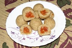 Gajrella (gajar ka halwa) Stuffed Til Mawa Laduu (in Hindi)