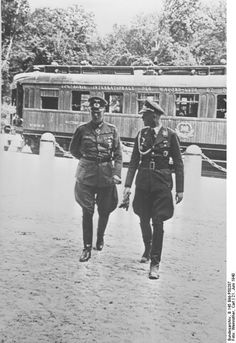 Wilhelm Keitel in front of the rail car that hosted the German surrender of 1918 and would soon host the French surrender of 1940, Compiègne, France, 22 Jun 1940. (German Federal Archive: B 145 Bild-P50287)