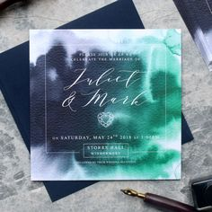 Featuring a Jade Green and Blue watercolour background with elegant script, this wedding invitation is perfect for the modern couple.  This invitation features your initials against a green watercolour background to one side, and your wedding details to the reverse. || QUANTITIES ||  This listing is for a sample only. Samples are not personalised.  || MADE FROM ||  These wedding invitations are digitally printed onto beautiful Italian Tintorretto Gesso card stock and come with a white…