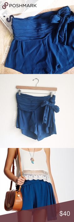 Free People tie waist wrap shorts Free People   Solid wrap shorts in Sapphire. These drapey high-rise shorts feature attached self-tie belt, ruched waist, and hidden side zip closure. Pair these flowy and feminine shorts with your favorite tee and booties for a boho chic look! In excellent, like new condition.   Size: 0  Materials: 100% Rayon Free People Shorts