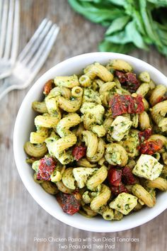 Pesto Chicken Pasta with Sun-Dried Tomatoes Recipe on twopeasandtheirpod.com. This quick and easy pasta dish is great for summer potlucks! #pasta