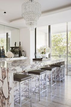 Love the marble bar and beautiful antique chandelier