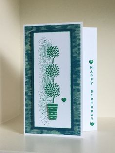Vertical Greetings topiary tree stamp with a background image from the Touches of Texture stamp set - created by Julia Jordan