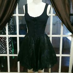 Betsey Johnson Vintage Fit & Flare Beautiful vintage dress with no flaws. No snags, rips, holes or tears. No stains. Zipper back with corset tie front and beautiful sheer skirt lining. Betsey Johnson Dresses Mini