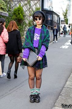 Nana's oversized tartan scarf is from Spinns, worn with a purple sweatshirt and Spinns skirt. Her studded clutch is WEGO, and she told us he...
