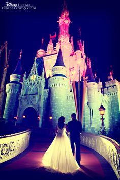 A picturesque shot of the bride + groom as the lights change on Cinderella Castle at Magic Kingdom Park