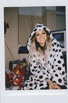 Has always been my favorite Lou pic ever. Hair, smile, makeup, onesie. ABSOLUTE PERFECTION.