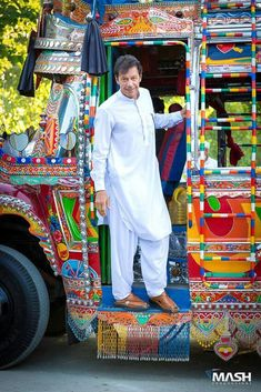 That colourful bus in the background and a handsome Man infront of it! :* This is Pakistan!