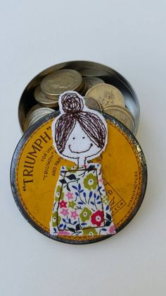 This wonderful little vintage tin has been embellished with a cheerful little girl who will happily look after any treasure you choice to keep inside.