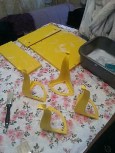 The disassembled yellow table...