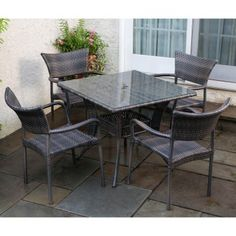 """Tutto All Weather Wicker 5 Piece Dining Set by Alfresco Home. $1339.00. 43-1306 Features: -Resin wicker is woven over durable cast aluminum frames.-Hose off to clean, never use harsh chemicals.-Resin wicker is UV tested for 3000 light hours. Includes: -Dining set includes: Tutto stackable dining arm chair, everwoven 36"""" square dining table. Color/Finish: -Exposed frames are powder coated with a bronze paint finish. Dimensions: -Table dimensions: 30"""" H x 36"""" W x 36"""" D.-Chair..."""