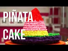 How To Cake… A PIÑATA SOMBRERO CAKE! Vanilla cakes layered with buttercream, and covered in a multi-coloured fondant fringe. And don't be surprised by candy comes cascading out when you cut (or smash!) into it. #CincoDeMayo #SurpriseInside #baking