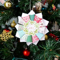 Create this paper ornament in less than 10 minutes to hang on your tree or give as a neighbor gift!