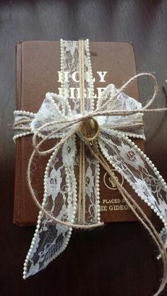 Using this in place of a traditional ring bearer pillow. Inexpensive alternative if you have a favorite book or bible at home. Using this in place of a traditional ring bearer pillow. Inexpensive alternative if you have a favorite book or bible at home. Wedding Bible, Diy Wedding, Dream Wedding, Rustic Wedding, Wedding Ideas, Alternative Wedding Rings, Alternative Bouquet, Ring Bearer Pillows, Ring Pillows
