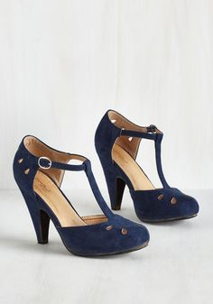 Team these playful navy T-straps up with your dynamic dance moves and watch as magic unfolds! Their tapered heels, teardrop-shaped cutouts with perforated accents, and faux-suede finish all put an oomph into your outfit that reps your other awesome characteristics.