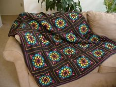 """Stained Glass Crochet... Interesting concept. Normally I have a firm """"no granny squares"""" and """"no rainbow colors together"""" policy.... but I might make an exception for this pattern. If done right I think it could be lovely."""
