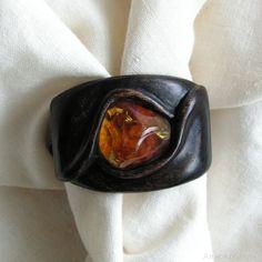 Hand-carved, wooden bracelet with natural baltic amber. Bracelets width: 4.2 cm; Circuit of a bracelet: 19cm;
