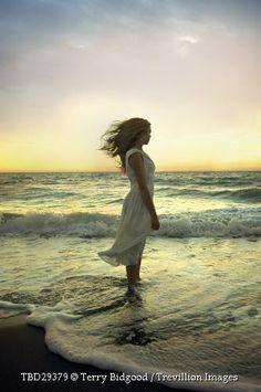 Trevillion Images - blonde-woman-on-breezy-beach