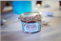 """Rustic wedding favors! Mini jelly jars with a twine bow and """"spread the love"""" label!"""