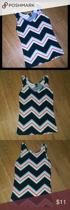 Multicolor Chevron Tank Top Super cute tank top with a chevron multicolor pattern. The size is L but it fits more like an M. Rue 21 Tops Tank Tops