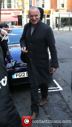 Sting stops to sign autographs for fans as he arrives at the BBC Radio 2 studios