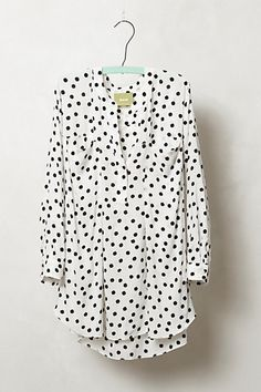 Ive been loving the small polka dots or spotty dots trend, but I dont like wearing traditional stiff collared shirts (too masculine.) This would be perfection - collarless, silky, and super feminine with a chic whimsical pattern that can be styled many different ways