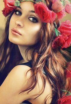 Pretty red flowers in her hair..<3