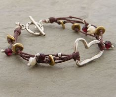 Handmade Jewelry Handmade Heart, cultured pearls, faceted garnet, copper and thai silver beads.) Multiple Strands and Silver Heart Leather Jewelry, Wire Jewelry, Jewelry Crafts, Beaded Jewelry, Jewelery, Jewelry Bracelets, Handmade Bracelets, Jewelry Ideas, Couple Bracelets