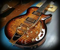 The bigsby looks great.......so does the flamed maple with sunburst carved top hollow