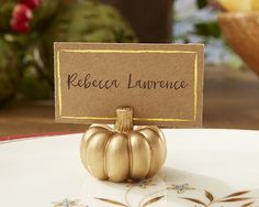 Perfect for fall weddings and Thanksgiving celebrations, our Gilded Gold Pumpkin Place Card Holder is sure to make a gorgeous autumn impression! Gold Pumpkin Place Card Holder leads your guests to the
