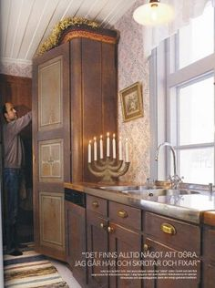 Brass handles, gorgeous candlestick and THAT cabinet!