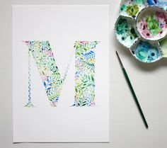 Watercolour wall art print of a letter M in a botanical theme.  This is an archival quality (giclee) print of a letter that was hand painted by me.