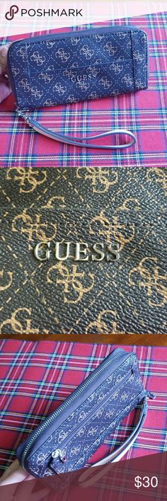 GUESS large zip around wallet NWOT Perfectly pretty and appointed with plenty of slots and packets for your cards and cash. Zip around closure , faux leather. Brand new. Guess Bags Wallets
