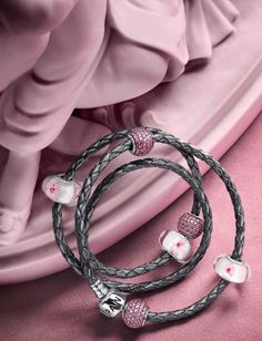 PANDORA Grey Braided Triple Leather Bracelet with Pretty Cherry Blossom Murano and Pink Pave Charms.