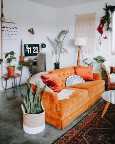 We moved things around for the time and the living room feels SO much b. We moved things around for the time and the living room feels SO much bigger 🙌 It's been stormy all day, and it's the perfect… My Living Room, Living Room Interior, Home And Living, Living Room Furniture, Living Spaces, Living Room Decor Orange, Orange Home Decor, Orange Decorations, Burnt Orange Living Room